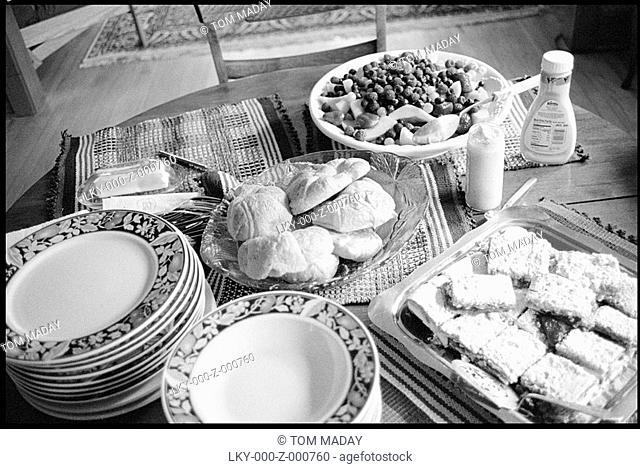 Dishes and food set on a table