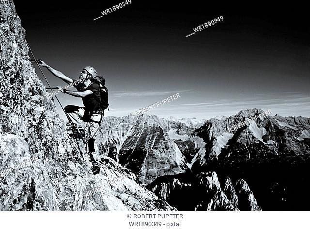 Alpinist rock climbing, Innsbruck route, Tyrol, Austria