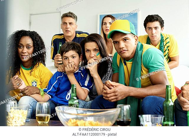 Brazilian soccer fans watching televised match together