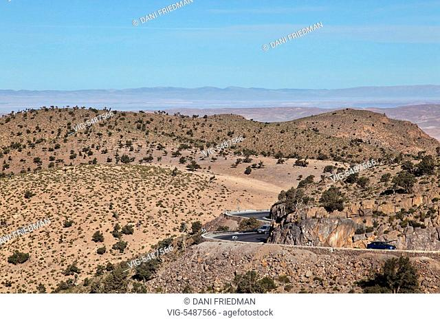 Vehicles travel along a mountain road in the High Atlas Mountains in Morocco, Africa. - MOROCCO, 02/01/2016