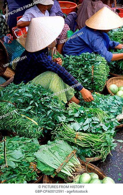 Vietnam: Fruit and vegetable vendors in a Vietnamese market