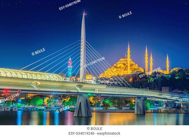 Ataturk bridge, metro bridge and golden horn at night - Istanbul, Turkey