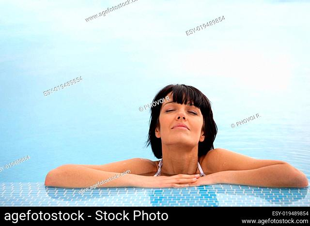 portrait of a woman bathing at the pool closed eyes face