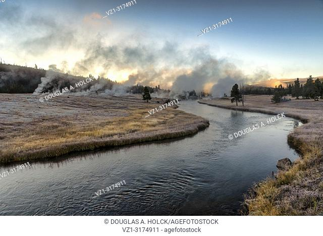 Sunrise over Thermal Activity on a Clear Frosty Fall morning on Freehole River Yellowstone National Park Wyoming USA