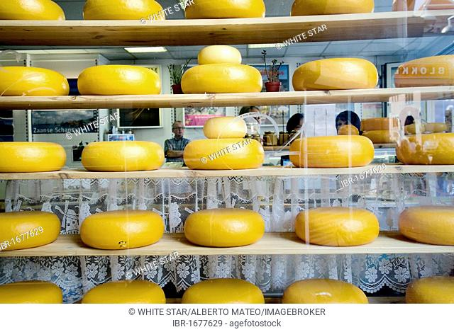 Cheese wheels in a shop on Damrak Street, city centre, Amsterdam, Netherlands, Europe
