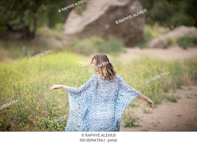 Woman dancing in park, Stoney Point, Topanga Canyon, Chatsworth, Los Angeles, California, USA