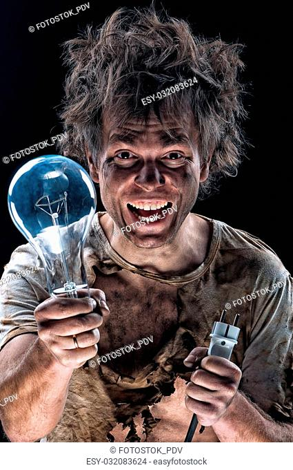 Portrait of funny electrician with lightbulb over black background