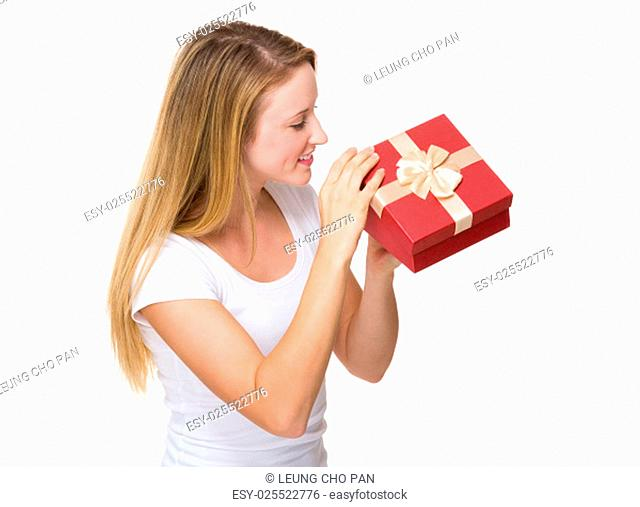 Woman look at giftbox