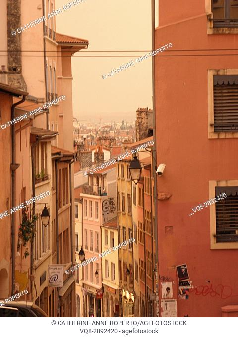 Warm mellow hues and repeating symmetry of traditional houses looking towards the historic city centre of Lyon, France