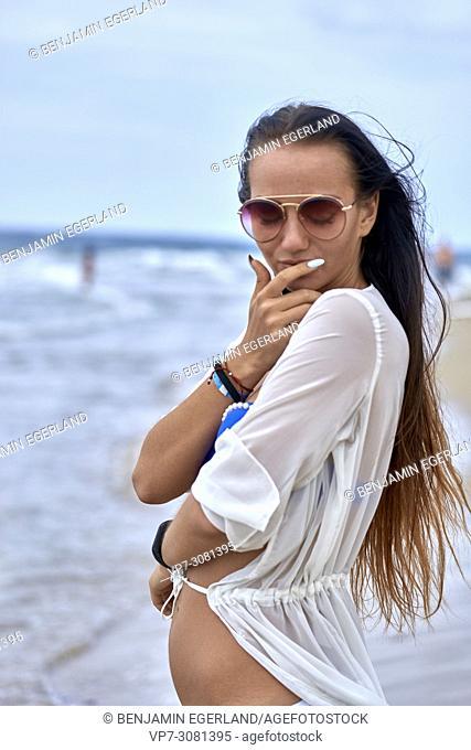 Young woman at beach in bikini. Malia, Crete, Greece