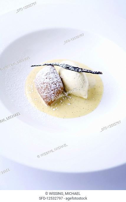 Deep-fried pastry with vanilla sauce and vanilla ice cream