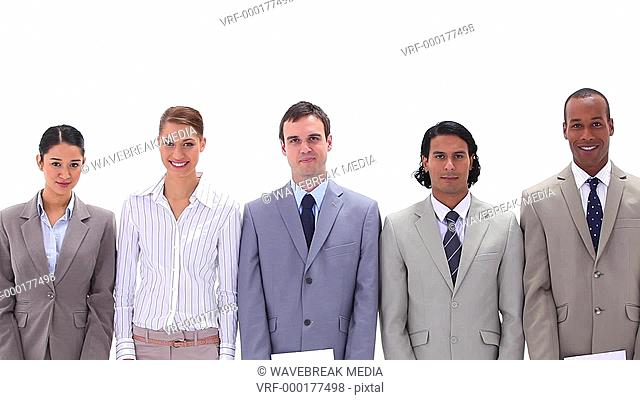Business people holding posters with the word GOALS a against white background