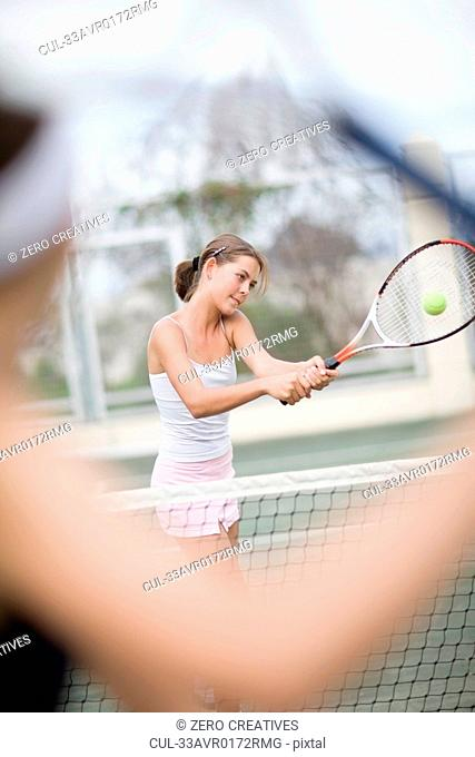 Serious girl playing tennis