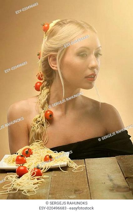 Art photo of young beautiful woman with pasta