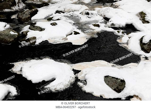 pattern of snow and water in river in winter