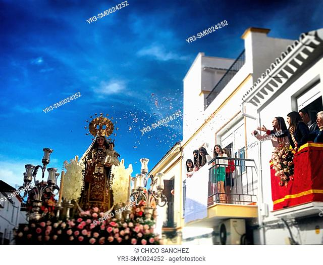 Young women throw flower petals to an image of Our Lady of Carmel (Nuestra Señora del Carmen) is displayed during Easter Holy Week in Prado del Rey