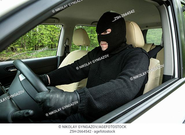 Russia. Theft Auto in the black mask in the vehicle