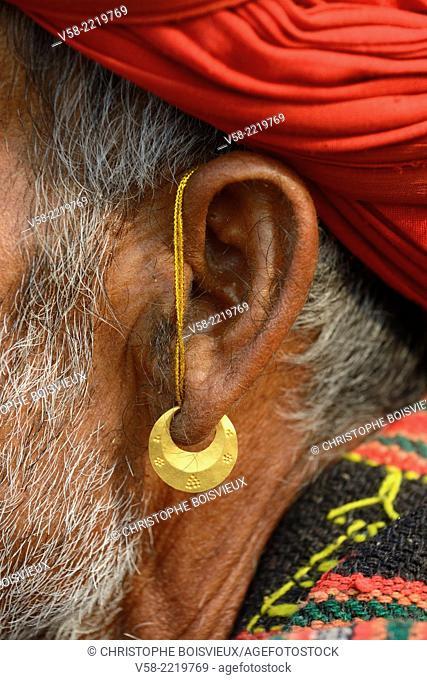 India, Rajasthan, Pushkar camel fair, Man wearing a golden earring