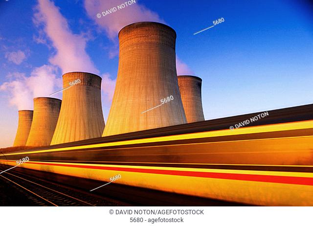 Train at speed. Coal-fired power station. Nottinghamshire. England