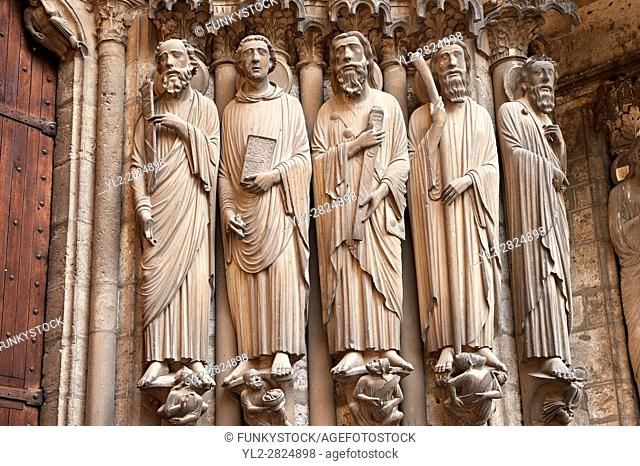 South Porch right jam. Cathedral of Chartres, France. Gothic statue of the Apostles (haloed, carrying the instruments of their deaths)