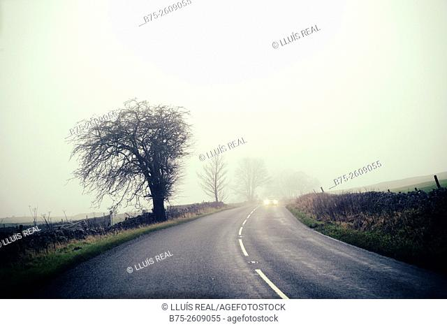 Rural road in a foggy day. Buckden, Upper Wharfedale, North Yorkshire, Yorshire Dales, Skipton, England, UK, Europe