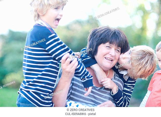 Grandmother with twin grandsons