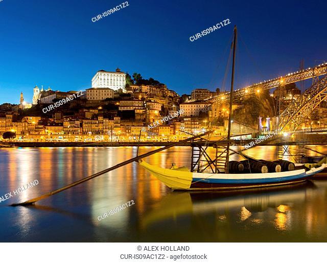 Rabelo boat on river Douro at night, Porto, Portugal