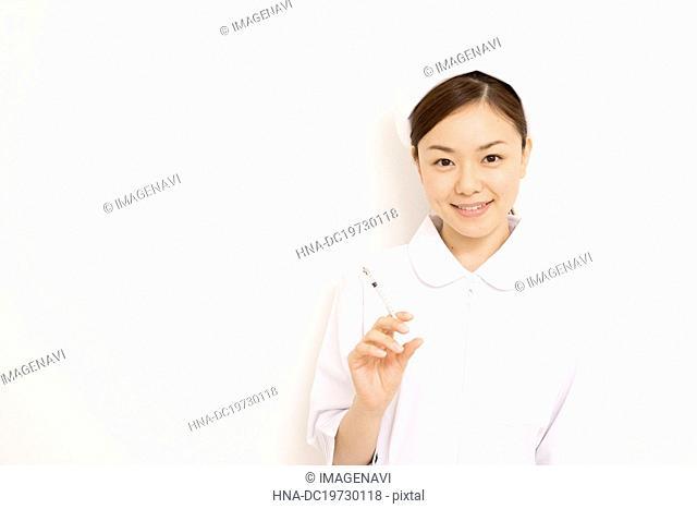White background, nurse holding a syringe