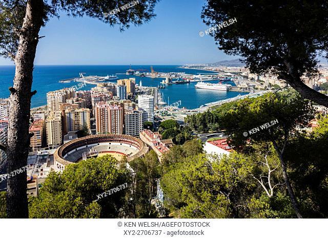 Malaga, Costa del Sol, Malaga Province, Andalusia, southern Spain. Overall view of bullring and port from National Parador (Parador Nacional)