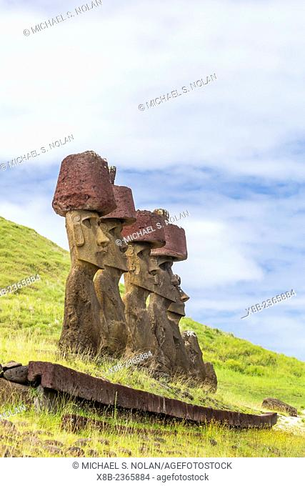 Moai with scoria red topknots at the restored ceremonial site of Ahu Nau Nau at Anakena on Easter Island, Isla de Pascua, Rapa Nui, Chile