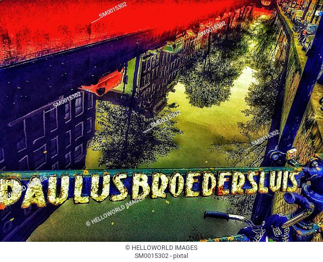 Reflection in canal from Paulusbroedersluis bridge which spans Oudezijds Achterburgwal, Amsterdam-Centrum, Amsterdam, Netherlands