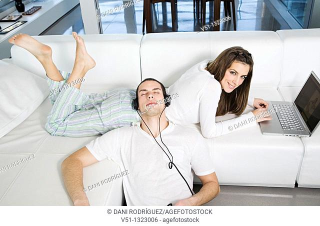 Young couple enjoying leisure at home
