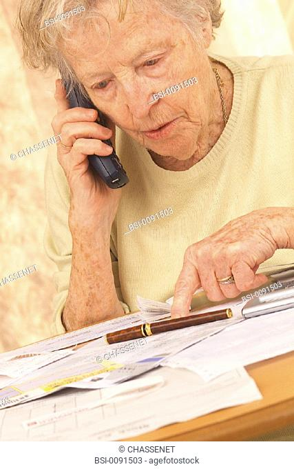 ELDERLY PERSON AT TELEPHONE<BR>Model