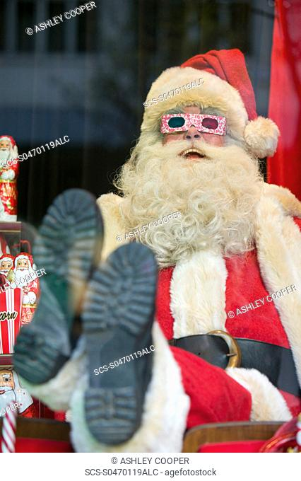 Father Christmas in a window display in a department store on Oxford Street in London