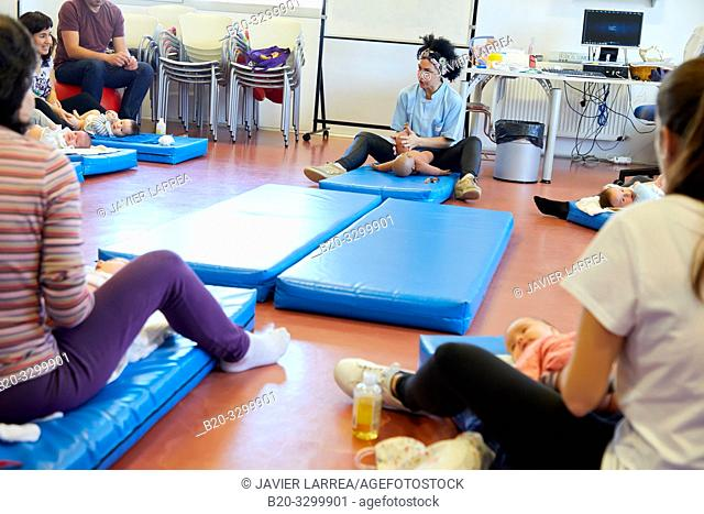 Matron instructing mothers in massage to babies, Health Center, Zarautz, Gipuzkoa, Basque Country, Spain