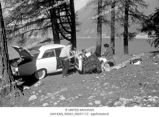 South Tyrol - Italy in 1960s - rest near Graun. Car parking lakeside of the Reschen reservoir, South Tyrol, Image date circa 1963. Photo Erich Andres