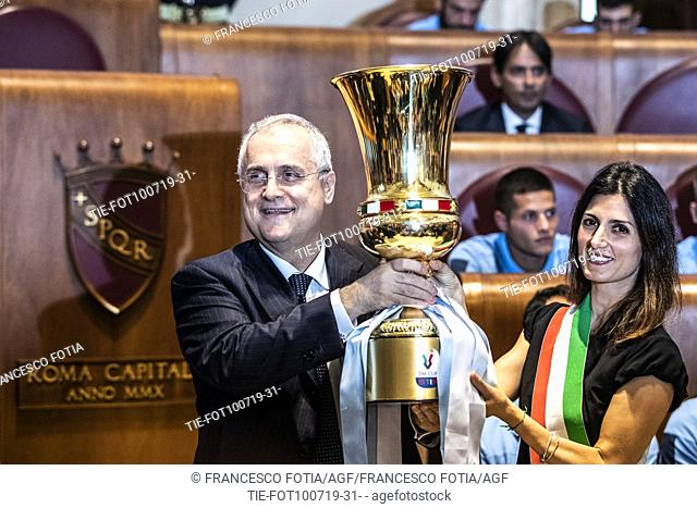 President of S.S. Lazio Claudio Lotito shows the Cup with Mayor of Rome Virginia Raggi during the prizegiving at Campidoglio Palace, Rome, ITALY-10-07-2019