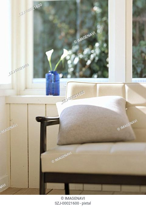 Sofa and arranged flowers