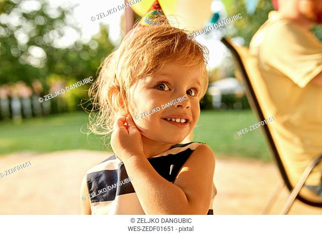 Portrait of little girl on a birthday garden party