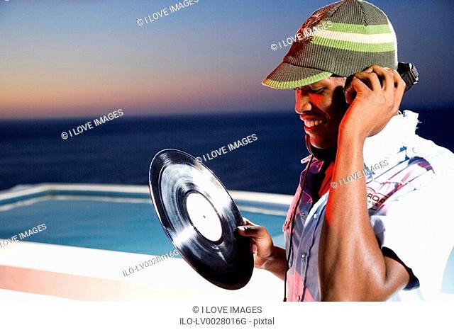 DJ selecting next record