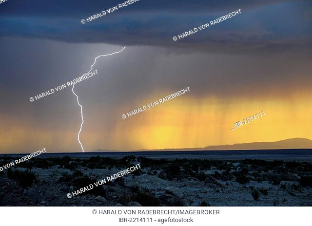 Stormy sky with rain and lightning at sunset, Altiplano, Bolivia, South America