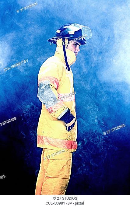 Portrait of firefighter in smoke