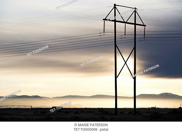 Power lines and tower at sunset