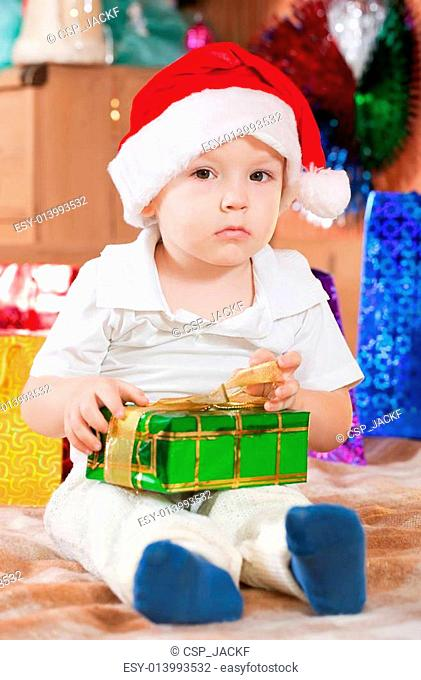 boy sits with Christmas gift