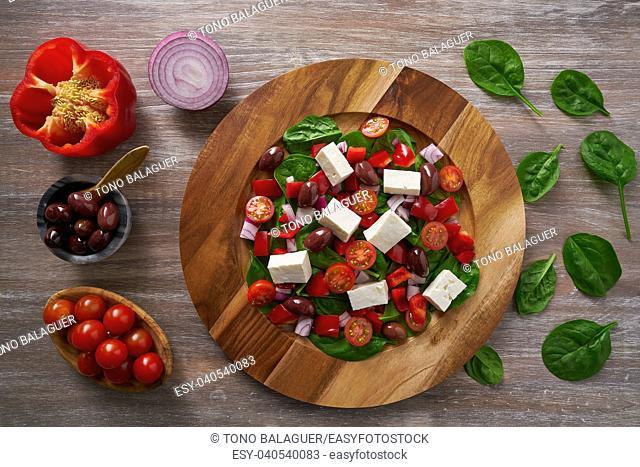 Cheese salad with tomatoes spinach and kalamata olives