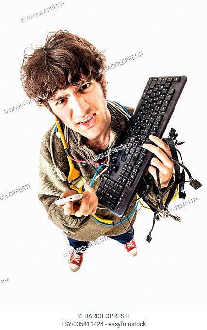 a casual guy with tangled cables and a keyboard struggeling to get computer assistance. isolated on white