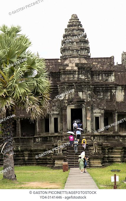 Tourists in Angkor Wat Temple, Angkor Temple Complex, Siem Reap Province, Cambodia, Asia, UNESCO. It was originally constructed as a Hindu temple dedicated to...