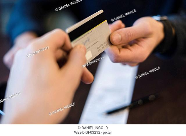 Customer paying with credit card, close-up