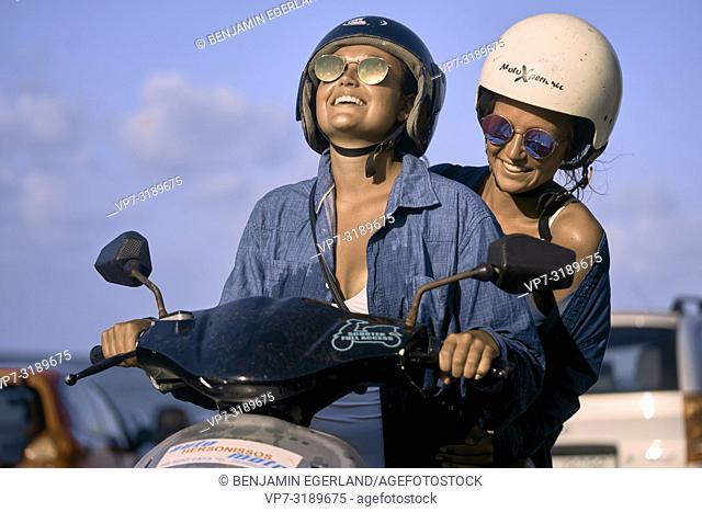 Two women driving scooter, Chersonissos, Crete, Greece