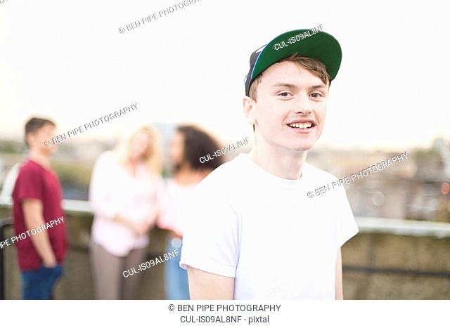Teenage boy wearing baseball cap